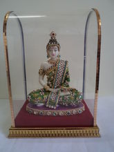 Lord Buddha in a glass box